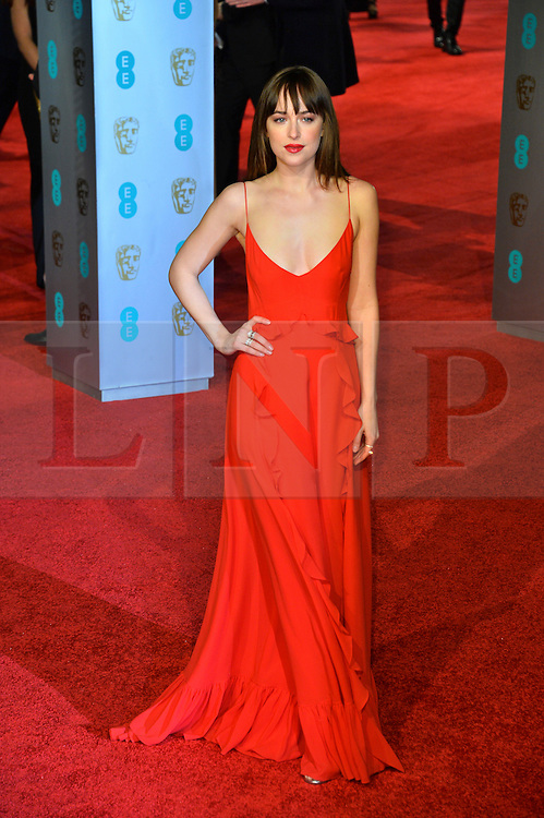 © Licensed to London News Pictures. 14/02/2016.  London, UK. DAKOTA JOHNSON arrives on the red carpet at the EE British Academy Film Awards 2016  Photo credit: Ray Tang/LNP