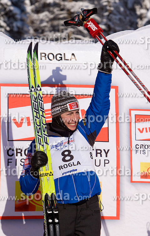 Winner Justyna Kowalczyk of Poland at medal ceremony after the Ladies 15 km Classic Mass Start Competition of Viessmann Cross Country FIS World Cup Rogla 2009, on December 20, 2009, in Rogla, Slovenia. (Photo by Vid Ponikvar / Sportida)