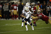 San Francisco 49ers defensive tackle Jullian Taylor (77) and Los Angeles Chargers quarterback Nic Shimonek (9) in action during the 2018 NFL preseason week 4 football game against the Los Angeles Chargers on Thursday, Aug. 30, 2018 in Santa Clara, Calif. The Chargers won the game 23-21. (©Paul Anthony Spinelli)
