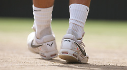 LONDON, ENGLAND - Sunday, July 4th, 2010: The Nike tennis shoes of Rafael Nadal (ESP) during the Gentlemen's Singles Final match on day thirteen of the Wimbledon Lawn Tennis Championships at the All England Lawn Tennis and Croquet Club. (Pic by David Rawcliffe/Propaganda)
