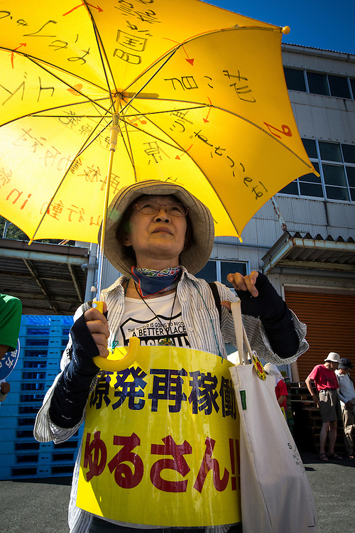 EHIME, JAPAN - AUGUST 11 : Anti-nuclear protester with signs during the protest against the restarting of a nuclear reactor on August 11, 2016 in Ikata Town, Ehime prefecture, northwestern Shikoku, Japan. The No. 3 reactor of the nuclear plant is expected to resume operations this week after The Nuclear Regulation Authority (NRA's) has completed it's final inspections of the plant's operational safety measures. The plant has not generated nuclear power since Japan's 2011 nationwide shutdown of all nuclear plants in the aftermath of the Fukushima Daiichi nuclear disaster. Ikata Nuclear Power Plant will be the third nuclear power plant in Japan to become operational. (Photo by Richard Atrero de Guzman/NURPhoto)