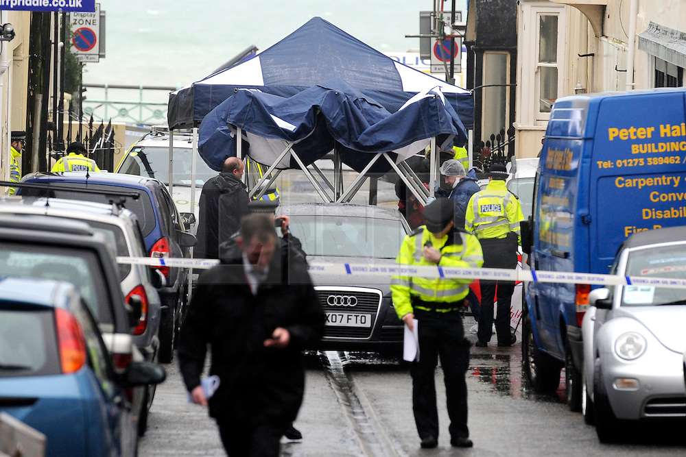 ©London News Pictures. 10/02/2011. Police and Forensics erect a covering in Rock Place Brighton after the shooting. A man shot by armed officers during a pre-planned operation has died in hospital. The man, who has not been named, was struck in Upper Rock Gardens, Brighton, East Sussex, at 1.03pm today (Thursday). Sussex Police said officers were on an operation to locate a man wanted in connection with a number of crimes in the county in recent months.. Photo credit should read: Peter Webb/London News Pictures