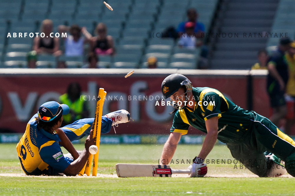 Jeevan Mendis attempts to run out George Bailey but runs into the stumps during game 1 of the Commonwealth Bank Series Australia v Sri Lanka played at the Melbourne Cricket Ground in Melbourne,Victoria, Australia. Photo Asanka Brendon Ratnayake