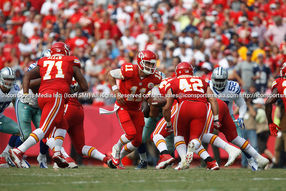 September 15, 2013: Kansas City Chiefs quarterback Alex Smith (11) prepares to hand off the ball during the Kansas City Chiefs 17-16 victory over the Dallas Cowboys at Arrowhead Stadium in Kansas City, Missouri.