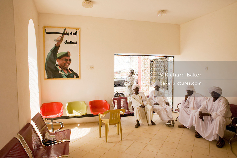 Beneath the imposing portrait of their Sudanese President in Al Fashir airport, Omar Hassan Ahmad al-Bashir, a group of Darfurian tribal elders await the entourage of British peer Lord Ahmed of Rotheram who has brought over from the UK, a delegation to attend the first-ever international Conference on Womens' Challenge in Darfur, hosted by the govenor in his own compound.