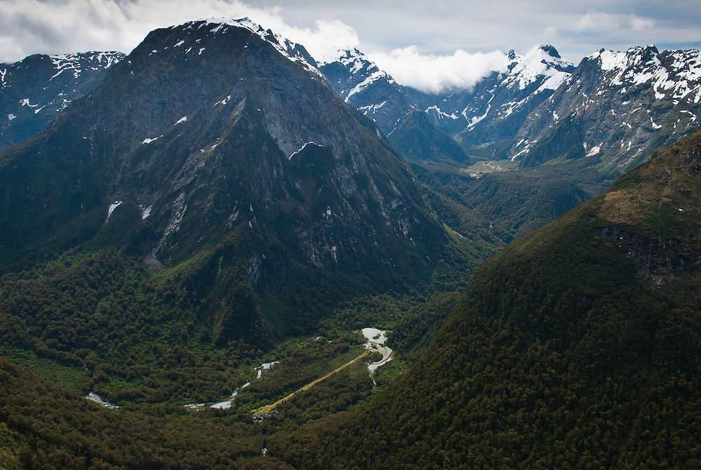 View from Mackinnon Pass of Quintin Lodge in Artur Valley at the foot of Mount Pillans, looking north along Green Valley to Mount Edgar, on the route of the Milford Track, New Zealand