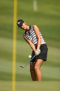 March 28, 2004; Rancho Mirage, CA, USA;  14 year old amateur Michelle Wie chips up onto the green on the 1st  hole during the final round of the LPGA Kraft Nabisco golf tournament held at Mission Hills Country Club.  Wie finished the day with a 1 under par 71.  Her overall score of 7 under par 281 was low enough to win low amateur honors and 4th place overall.<br />Mandatory Credit: Photo by Darrell Miho <br />&copy; Copyright Darrell Miho