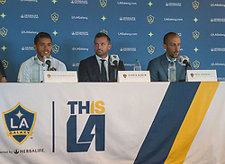 July 28, 2017 - Carson, California, U.S - Jonathan dos Santos is presented to the media during a press conference after joining the L.A. Galaxy at StubHub Center in Carson, California on Friday, July 28, 2017. Jonathan dos Santos joins the L.A. Galaxy. (L-R) Jonathan dos Santos, L.A. Galaxy president Chris Klein,  and General Manager, Peter Vagenas. (Credit Image: © Prensa Internacional via ZUMA Wire)