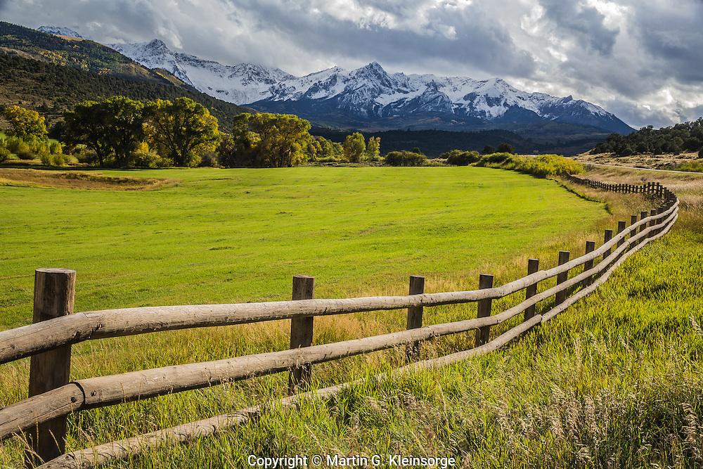 Open ranchland below the Sneffels Range during the autumn season,  Colorado.