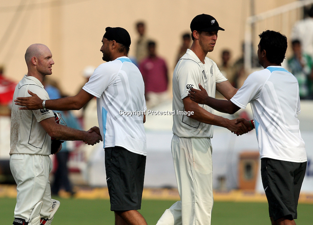 Indian players Harbhajan Singh and Pragiyan Ojha shekh hand with New Zealand Playres After finish 2nd test match during the Indian vs New Zealand 2nd test match day-5 Played at Rajiv Gandhi International Stadium, Uppal, Hyderabad 16 November 2010 (5-day match)
