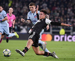 TURIN, Nov. 27, 2019  FC Juventus' Paulo Dybala (Front) vies with Atletico Madrid's Kieran Trippier during the UEFA Champions League Group D match between FC Juventus and Atletico Madrid in Turin, Italy, Nov. 26, 2019. (Photo by Federico Tardito/Xinhua) (Credit Image: © Cheng Tingting/Xinhua via ZUMA Wire)