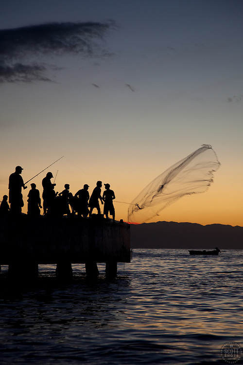 """Fishermen in Puerto Vallarta 1"" - These men fishing and throwing nets were photographed at sunset in Puerto Vallarta, Mexico."
