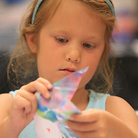 Isabelle Fletcher, 6, from Mobile Alabama, cuts out shapes for her house as she attends art camp this week at the Ole Miss-Tupelo campus. Isabelle is visiting her cousins and attending the camp.