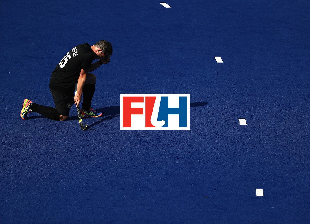 RIO DE JANEIRO, BRAZIL - AUGUST 06:  Shea Mcaleese #25 of New Zealand kneels during a Pool A match between New Zealand and Austraiia  on Day 1 of the Rio 2016 Olympic Games at the Olympic Hockey Centre on August 6, 2016 in Rio de Janeiro, Brazil.  (Photo by Sean M. Haffey/Getty Images)