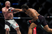 Rafael Natal throws a punch against Tim Boetsch during UFC 205 at Madison Square Garden in New York, New York on November 12, 2016.  (Cooper Neill for The Players Tribune)