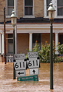 EASTON, PA - JUNE 29: Street signs are covered as flood waters crest along the Delaware River June 29, 2006 in Easton, Pennsylvania. Gov. Ed Rendell declared a disaster emergency in 46 of the state's 67 counties Wednesday. (Photo by William Thomas Cain/Getty Images)