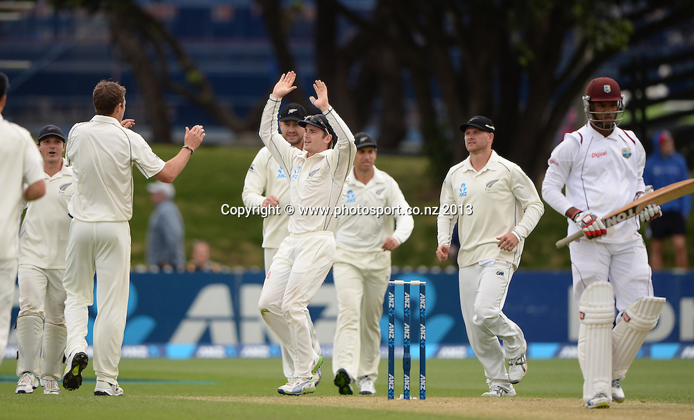 Tim Southee celebrates the dismissal of Kieran Powell with Kane Williamson and team mates on Day 2 of the 2nd cricket test match of the ANZ Test Series. New Zealand Black Caps v West Indies at The Basin Reserve in Wellington. Thursday 12 December 2013. Mandatory Photo Credit: Andrew Cornaga www.Photosport.co.nz