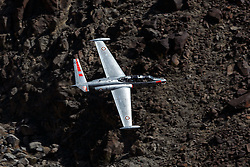A Fouga CM-170 Magister (registration N315MB) flies low level through Jedi Transition, R-2508 complex, Star Wars Canyon / Rainbow Canyon, Death Valley National Park, California, United States of America.