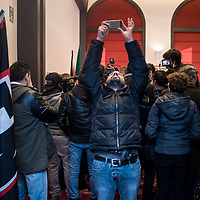 Como, Italy - 9 December 2017: A militant of Italy's neo-fascist Forza Nuova movement after Roberto Fiore's press conference at Palace Hotel. Italy's Democrats led a rally at the same time a few hundreds meters away to warn about a comeback of fascist movements in the country.