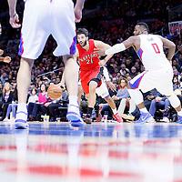 27 December 2014: Toronto Raptors guard Greivis Vasquez (21) drives past Los Angeles Clippers forward Glen Davis (0) during the Toronto Raptors 110-98 victory over the Los Angeles Clippers, at the Staples Center, Los Angeles, California, USA.