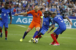 France's Layvin Kurzawa and N'Golo Kante battling Netherlands's Arjen Robben during the World Cup 2018 Group A qualifications soccer match, France vs Netherlands at Stade de France in Saint-Denis, suburb of Paris, France on August 31st, 2017 France won 4-0. Photo by Henri Szwarc/ABACAPRESS.COM