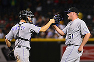 PHOENIX, AZ - APRIL 30:  Jake McGee #51 of the Colorado Rockies is congrateulated by Nick Hundley #4 after closing out the game against the Arizona Diamondbacks at Chase Field on April 30, 2016 in Phoenix, Arizona. The Colorado Rockies won 5-2.  (Photo by Jennifer Stewart/Getty Images)