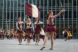© licensed to London News Pictures. London, UK 17/05/2012. Cheerleaders posing in Canary Wharf as the Trojan Marching Band of the University of Southern California comes to Canary Wharf for the first time performance in Canada Square Park this evening (17/05/12). Photo credit: Tolga Akmen/LNP