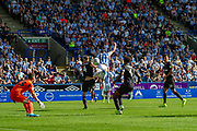Huddersfield Town Karlon Grant attempts to head the ball during the EFL Sky Bet Championship match between Huddersfield Town and Reading at the John Smiths Stadium, Huddersfield, England on 24 August 2019.
