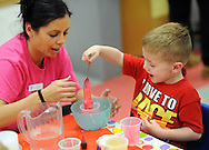 Gabrielle Ostroski(left) shows J.P. Shanahan (right) how to make slime during YMCA 'Healthy Kids Day'  Saturday April 30, 2016 in Mt. Laurel, New Jersey.  (Photo by William Thomas Cain)