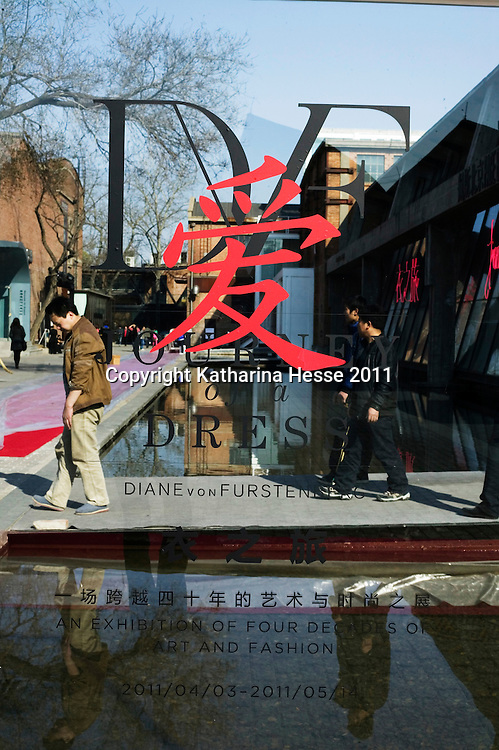 """Beijing, April,2, 2011 : an ad for the """" JOurney of the Dress"""" exhibition is seen outside the Pace Gallery in Beiing."""