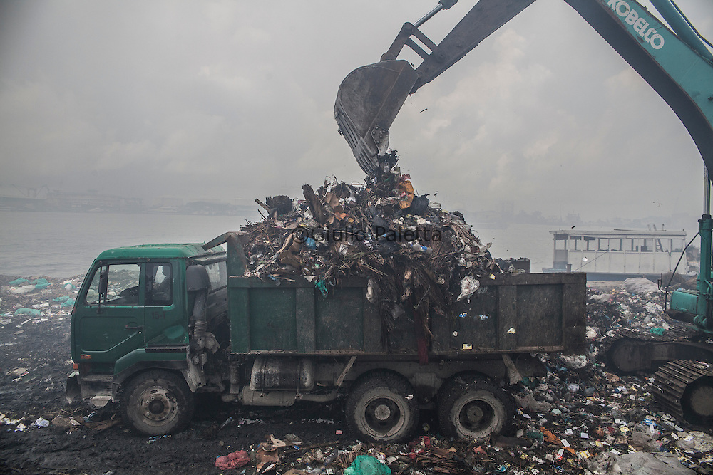 "Bengalese workers at the dump on Thilafushi island, the so-called ""rubbish island"". Created to collect and burn all the garbage coming from the capital island Male and all the tourists resorts"