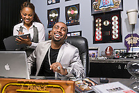 Jas Prince is CEO of Houston-based Rap-a-Lot Records. Photographed in his office, I wanted a shot that related to his past and his friendships, alluded to his current projects, and his business success