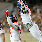 Mississippi defensive back Trae Elston (7), right, jumps to congratulate linebacker Keith Lewis (24) after Lewis returned a Texas A&M fumble for a touchdown during the second half of an NCAA college football game in College Station, Texas, Saturday, Oct. 11, 2014. No. 3 Mississippi won 35-20. (Photo/Thomas Graning)