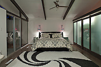 Bedroom with rug and sliding door in luxury manor house