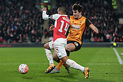 Harry Maguire (Hull City) fouls Theo Walcott (Arsenal) just outside the box during the The FA Cup fifth round match between Hull City and Arsenal at the KC Stadium, Kingston upon Hull, England on 8 March 2016. Photo by Mark P Doherty.