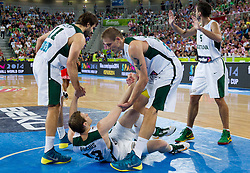 Linas Kleiza #11 of Lithuania and Roberas Javtokas #15 of Lithuania helping Martynas Pocius #13 of Lithuania during basketball match between National teams of Lithuania and Croatia in Semifinals at Day 17 of Eurobasket 2013 on September 20, 2013 in Arena Stozice, Ljubljana, Slovenia. (Photo by Vid Ponikvar / Sportida.com)