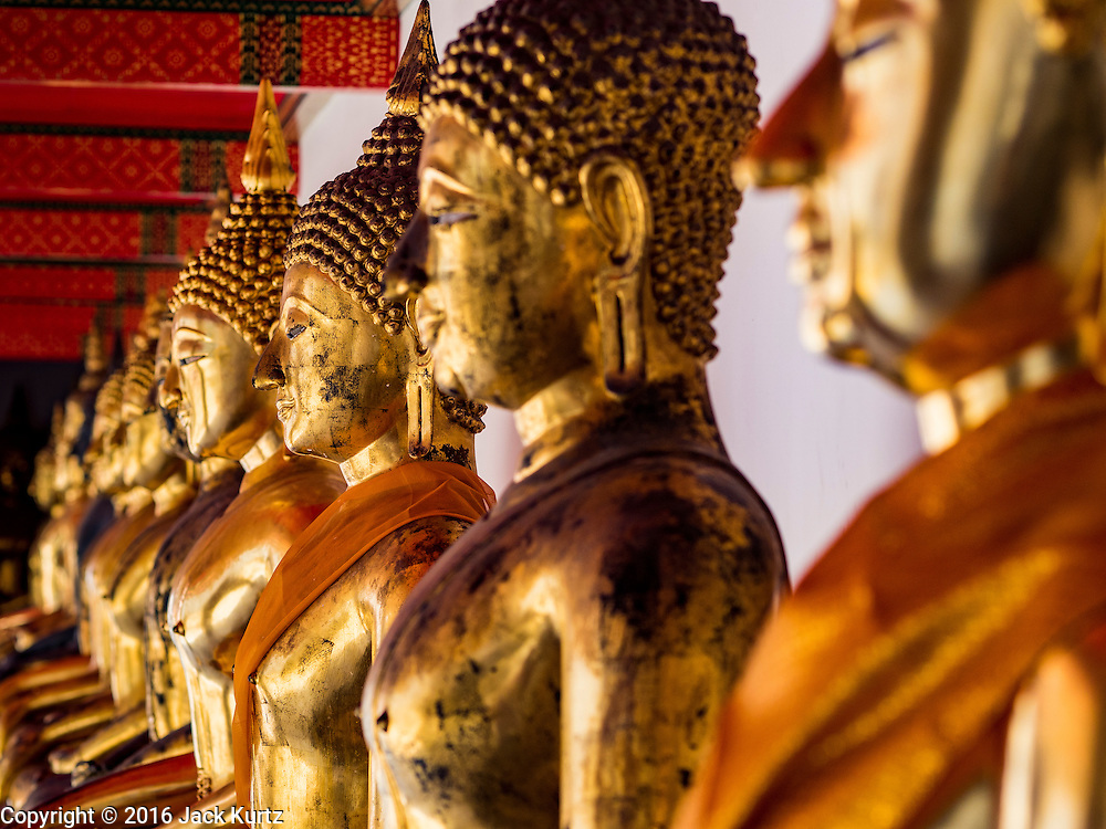 11 AUGUST 2016 - BANGKOK, THAILAND: Statues of the Buddha line the porticos that surround Wat Pho in Bangkok. Wat Pho (the Temple of the Reclining Buddha), is formally known as Wat Phra Chetuphon. It's one of the largest temple complexes in Bangkok and best known for the giant reclining Buddha that measures 46 metres long and is covered in gold leaf. There is also a large ordination hall and the best known massage school in Thailand on the temple grounds.          PHOTO BY JACK KURTZ
