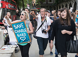 © Licensed to London News Pictures. 10/07/2017. Supporters of terminally ill baby Charlie Gard shout as officials from Great Ormond Street Hospital leave The High Court. The parents of Charlie Gard are returning to court in light of claims of new evidence relating to potential treatment for his condition. An earlier lengthy legal battle ruled that Charlie could not be taken to the US for experimental treatment. London, UK. Photo credit: Peter Macdiarmid/LNP