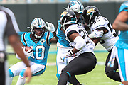 Sunday, October 6, 2019; Charlotte, N.C., USA;  Carolina Panthers quarterback Kyle Allen (7) tosses a shovel  pass to  wide receiver Curtis Samuel (10) during an NFL game against the Jacksonville Jaguars at Bank of America Stadium. The Carolina Panthers beat the Jacksonville Jaguars 34-27. (Brian Villanueva/Image of Sport)