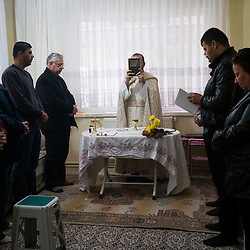 Father Adday celebrates mass at an apartment in Kirsehir, Turkey.<br /> &ldquo;A mass in a house is more like a family. Father and children sharing the glory of God&rdquo;. &ldquo;I would say it is like watching a film in a movie theater versus watching it at home with your family,&rdquo; Father Adday explains.