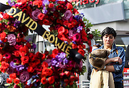 A fan cries at a makeshift memorial surrounds David Bowie's star on the Hollywood Walk of Fame in Los Angeles, Monday, Jan. 11, 2016. Bowie, the infinitely changeable, fiercely forward-looking songwriter who taught generations of musicians about the power of drama, images and personae, died Sunday surrounded by family. He was 69. Bowie died after an 18-month battle with cancer. (Photo by Ringo Chiu/PHOTOFORMULA.com)<br /> <br /> Usage Notes: This content is intended for editorial use only. For other uses, additional clearances may be required.