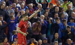 LIVERPOOL, ENGLAND - Wednesday, September 23, 2015: Liverpool's James Milner celebrates scoring the first penalty of the shoot-out against Carlisle United during the Football League Cup 3rd Round match at Anfield. (Pic by David Rawcliffe/Propaganda)