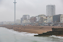 © Licensed to London News Pictures. 08/04/2018. Brighton, UK. The Brighton Palace pier stands on an near empty beach as rain is hitting Brighton and Hove. Photo credit: Hugo Michiels/LNP