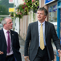 Secretary of State for Scotland Michael Moore MP pictured walking through the village of Bridge of Earn with local Lib Dem Cllr Peter Barrett whilst on visit to Perthshire...29.08.12<br /> Picture by Graeme Hart.<br /> Copyright Perthshire Picture Agency<br /> Tel: 01738 623350  Mobile: 07990 594431