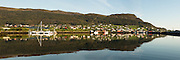 Panoramic view at Kvalsund, Norway. Early morning light with reflections in the sea   Nydelig morgenlys på Kvalsund, med spegling i sjøen