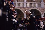 12. National holiday: Prince Rainier awards medals of the Order of Grimaldi in the palace's cour d'honneur.   Le prince Rainier remet des médailles de l'ordre des Grimaldi dans la cour d'honneur du palais,  pendant  la fête nationale:  288286/7    L921119b  /  P0000342