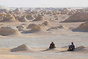 "Mahmood & Khaled rest after trekking amongst El-Khiyam ""The Tents"",  Sahara Beida (White Desert), Egypt"