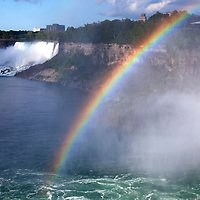Canada, Ontario, Niagara Falls. Rainbow in mist of Niagara Falls.
