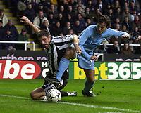 Photo. Glyn Thomas ,Digitalsport<br /> Newcastle United v Tottenham Hotspur. FA Barclaycard Premiership. St James' Park, Newcastle. 13/12/2003.<br /> Newcastle's Aaron Hughes (L) is pulled down by Mauricio Taricco.