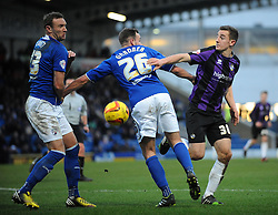 Bristol Rovers' Tom Lockyer jostles for the ball with Chesterfield's Dan Gardner and Chesterfield's Ian Evatt - Photo mandatory by-line: Dougie Allward/JMP - Tel: Mobile: 07966 386802 01/02/2014 - SPORT - FOOTBALL - Proact Stadium - Chesterfield - Chesterfield v Bristol Rovers - Sky Bet League Two